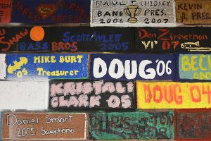 Painted bricks in the band room a reminders of memories from graduates from many years.