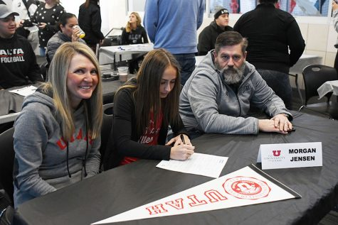 Morgan Jensen signs her letter of intent to run track for the University of Utah at this year