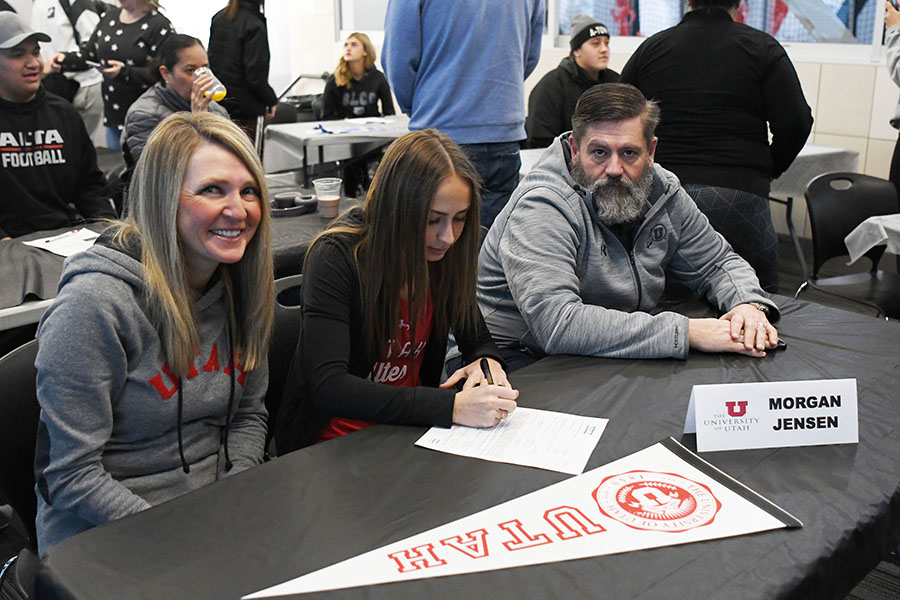Morgan Jensen signs her letter of intent to run track for the University of Utah at this year's College Signing Day.
