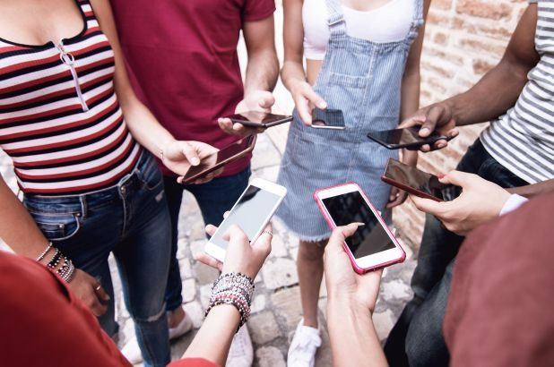 Do teens spend too much time on their cell phones. Pros and Cons exist for both sides.