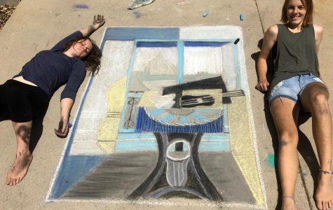 Emma and Hannah Cecil proudly display their chalk the walk art.