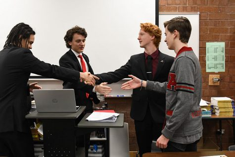 Davidson Pierson, Ian Whatley, Daniel Ross, and Gage Jeppson pose for a mock debate photo.