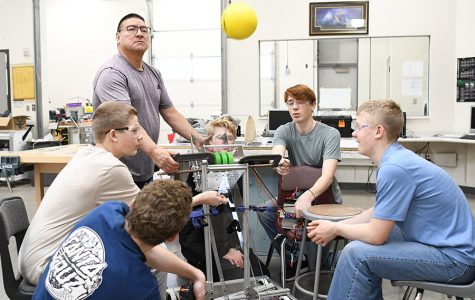 Mr. Ron Strohm and his team test their robot for an upcoming competition.