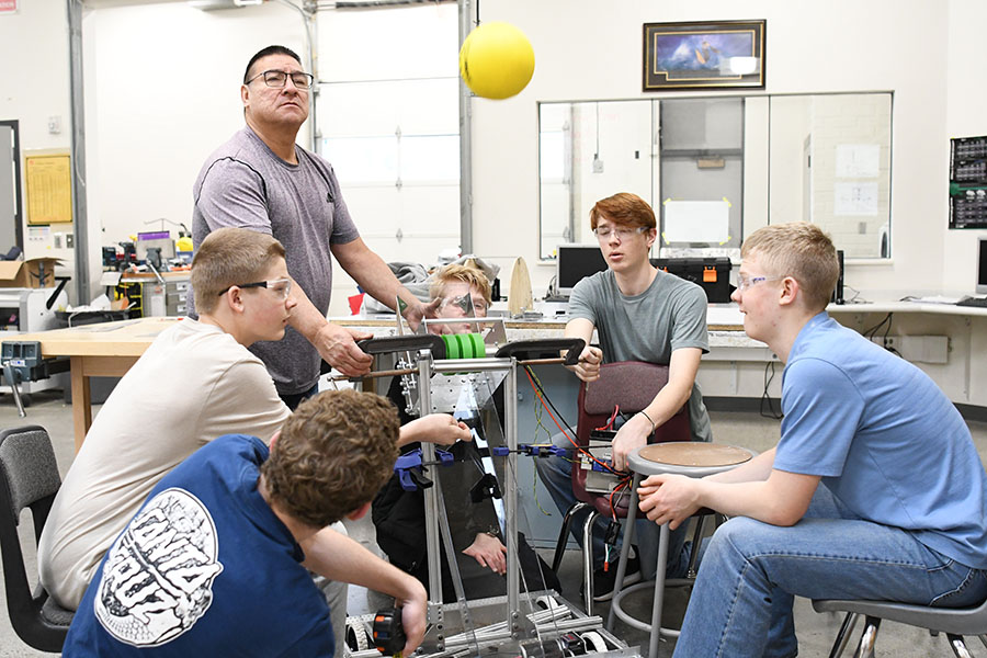 Mr.+Ron+Strohm+and+his+team+test+their+robot+for+an+upcoming+competition.