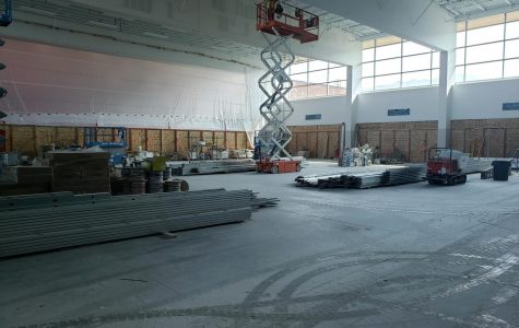 Construction crews put the finishing touches on the ceiling in the newly remodeled commons.