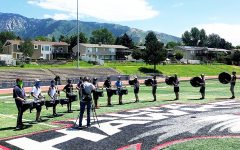 Marching Band Endures Sun, Shade, and Rain as They Prepare for their Upcoming Competitions