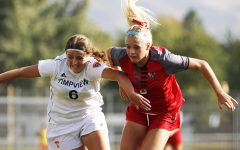 Macy Ellis fights her Timpview opponent for the ball.