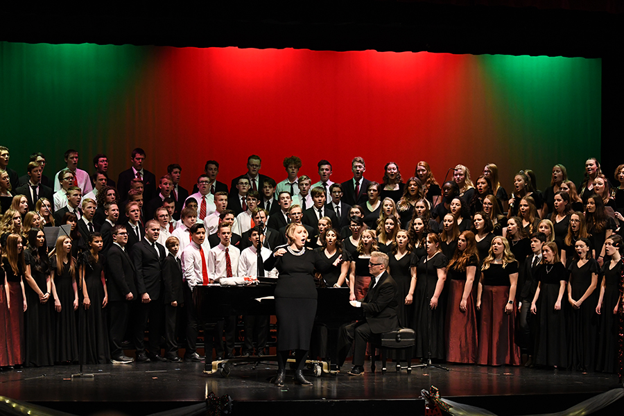 Ms. Iund leads last year's choirs in a group number at the yearly holiday concert.