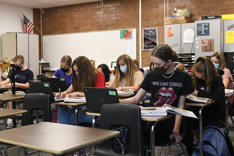 Students sit close together in an Alta classroom in September; the new hybrid schedule will decrease the number of students in all classes which will increase the ability to socially distance and prevent the spread of the Covid-19 virus.