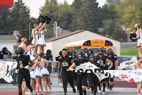 Fottball players rush onto the field in preparation for their Homecoming game with Timpanogos. Alta won 56-13.