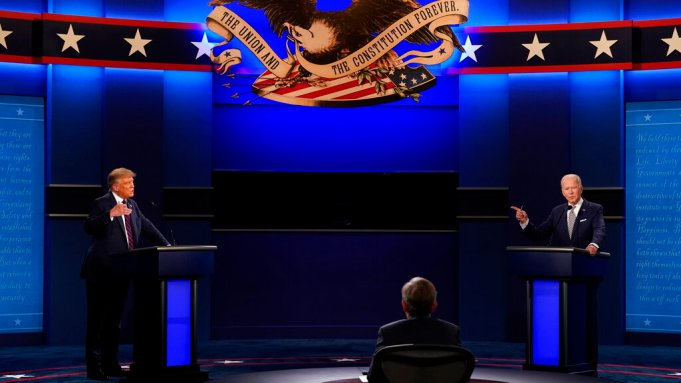 President Donald Trump, left, and Democratic presidential candidate former Vice President Joe Biden, right, with moderator Chris Wallace, center, of Fox News during the first presidential debate Tuesday, Sept. 29, 2020, at Case Western University and Cleveland Clinic, in Cleveland, Ohio.