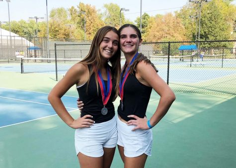Raquel Passey and Brooklyn Dowdell pose for a post state tournament photo after their second place state finish.