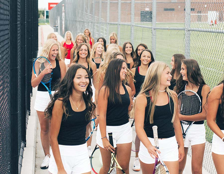 This year's Girls' Tennis Team enjoys being together and improving their skills on the court.