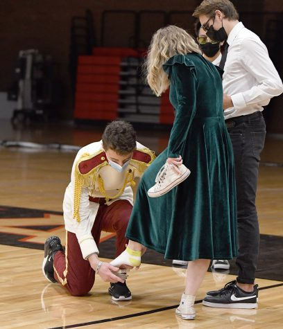 Zach Scheffner, aka Prince Charming, seeks his princess by trying on the glass slipper.