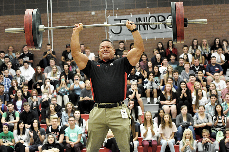 Dr. Brian McGill deadlifts 245 pounds to the cheers of students at the 2015 Hello Assembly.