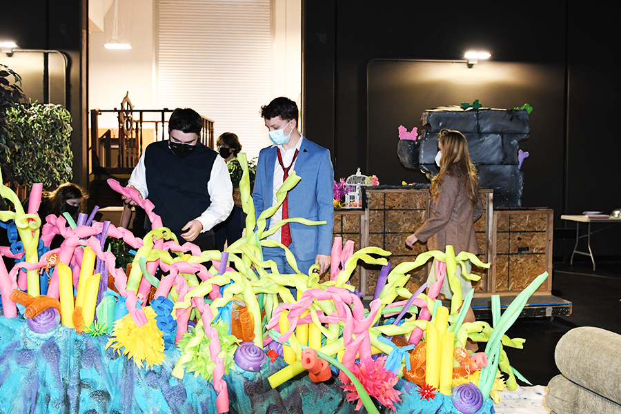 Students examne underwater scenery that will be used in this year's on stage musical, The Little Mermaid. Tickets are $10 and can be ordered on line on the school website: ahs.canyonsdistrict.org.