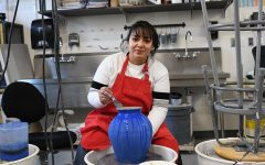 Joahna Lemus works on the potter's wheel in her ceramics class. Joahna's art was accepted into the Utah High School Art Show this month. Three other students also had work accepted into this juried show.