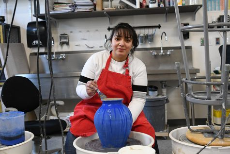 Joahna Lemus works on the potter