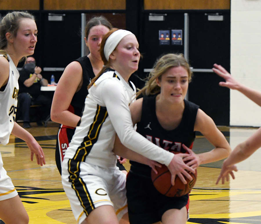 Senior Sadie Strate fends off the opposition on her way to the basket.