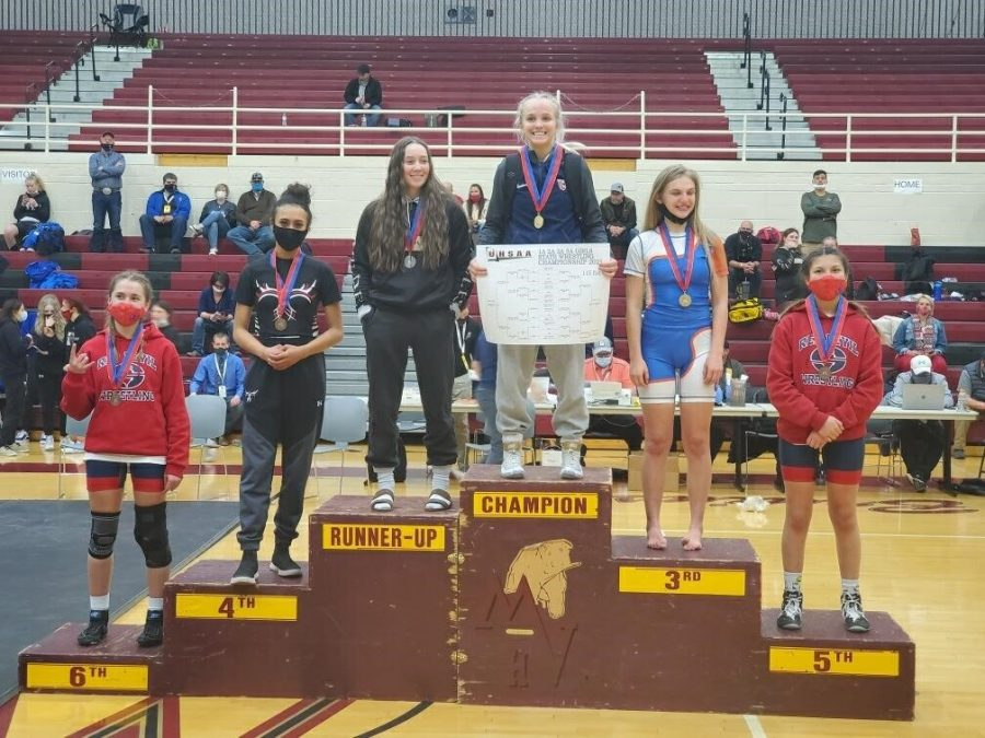 Siarra Sherod, second from the left stands on the podium to receive her fourth place medal for the 110 pound weight division at state competition in Heber City at the end of February.