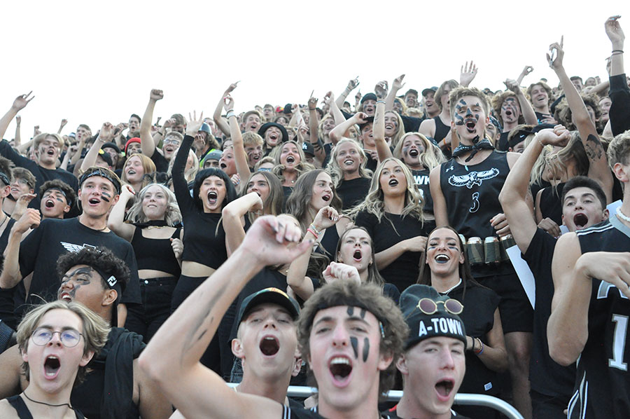 Student section cheers on Alta's football team.