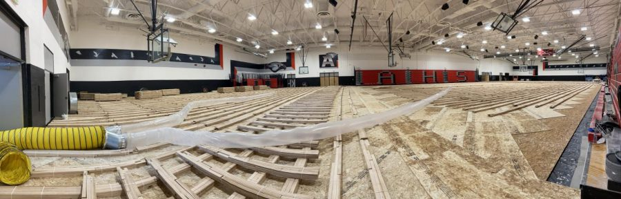 The gym remodel is going great, with newly painted school symbols and colors on the walls. The gym floor is curing so it wont warp once its laid.