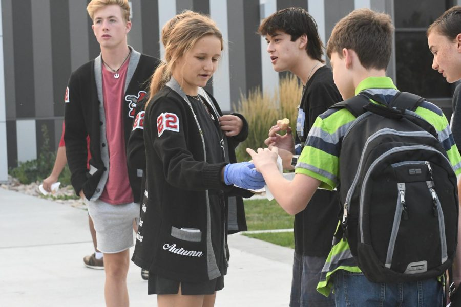 Student Body President Autumn Engstrom passes out donuts as a welcome gesture on the first day of school.