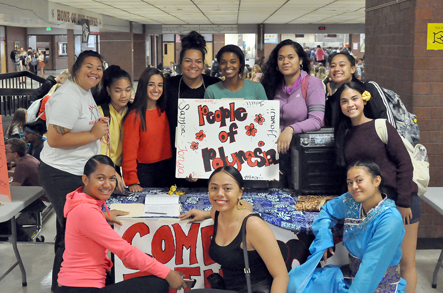 Members of the People of Polynesia club pose at the Club Rush held in the commons in the fall of 2019.