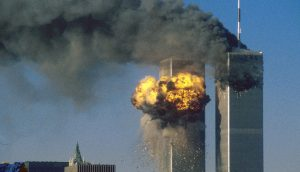 The World Trade Center south tower (L) burst into flames after being struck by hijacked United Airlines Flight 175 as the north tower burns following an earlier attack by a hijacked airliner in New York City September 11, 2001.