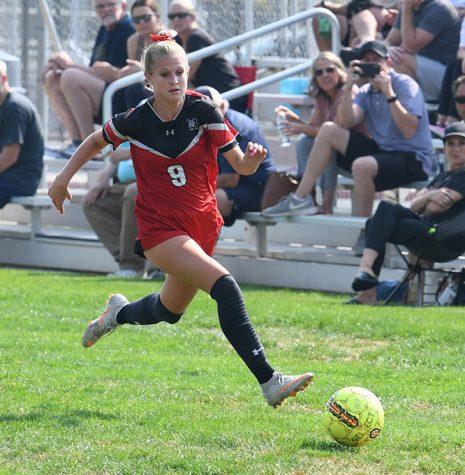 Sophomore Ella Labrum makes a break for the goal in the match against Jordan.