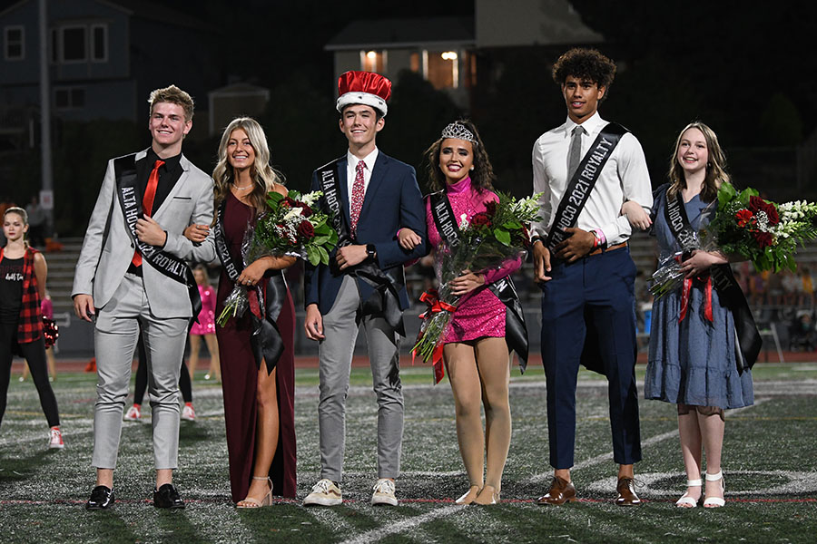 Homecoming royalty Jett Lundberg & Lucy Lesueur, Russell Affleck & Kate Spencer, Maika Kaufusi & Anna Teichert pose for a photo after the royalty presentation at this years Homecoming game against Timpview.