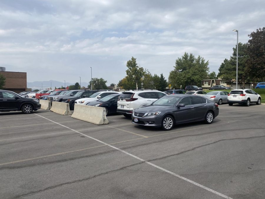 Cement dividers placed in the faculty parking lot section off a new area for student parking.