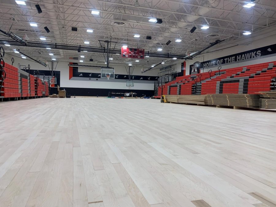 Crews+are+busy+installing+the+new+gym+floor.+If+all+goes+well%2C+the+gym+will+be+open+for+business+the+first+part+of+November.