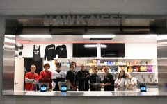 The B Day school store staff poses on the Hawk Nests opening day. The Nest is now open for business.