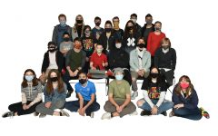 Last years Happynings Club poses for a yearbook photo. This club is about serving, helping, and mentoring others.