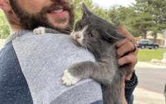 Tired and cold, Gandalf hugs band director Caleb Shabestari after his fortunate rescue during marching band practice.